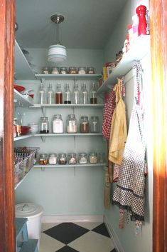 farmhouse pantry.. love everything in jars and the pale blue with black & white floors..