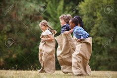 Interracial Group Of Kids Competing At A Sack Race In Summer Stock Photo, Picture And Royalty Free Image. Image 48658700.
