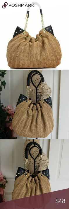 Olivia and Joy purse Charming Olivia and Joy straw woven purse. Black and tan woven straw. Excellent condition.  Golden hardware. 4 pockets inside. One with zipper.  One pin in the back is missing. Please check last picture. Olivia + Joy Bags