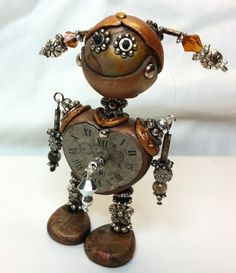 This unique little Steampunk Robot stands about 3 inches tall. He was assembled from polymer clay, bits of metal and Swarovski by crystals. No molds by NyliramClayFun Recycled Robot, Recycled Art, Repurposed, Yard Sculptures, Metal Sculptures, Polymer Clay Steampunk, Metal Art Projects, Tin Man, Found Object Art