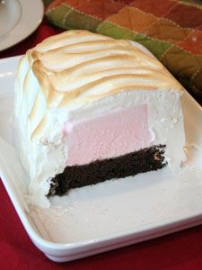 Baked Alaska- brownie or sheet cake, topped with icecream, and meringue. It is baked in the oven. The meringue actually protects the icecream while baking so it doesn't melt! I can't wait to try this!