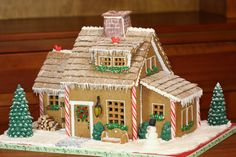 Icicle-Trimmed Gingerbread House: There are plenty of intricate details to glean from this classic house. Our top picks: candy-cane trim on the house corners, piped pine trees with an ice cream cone base, and cereal bricks for roof tiles.  Source: Sweetopia