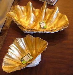 Paint shells with metallic paint perhaps put tea lights in them, instant summer decor!