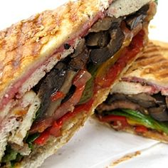 The perfectly pressed vegan panini, with grilled tofu, portabella mushrooms, olives, peppers and laced with a raspberry vinaigrette
