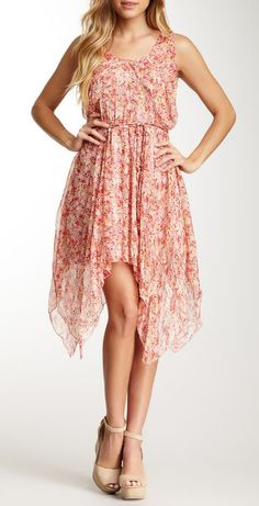 I love the high low ruffles down the bottom. I can imagine it flowing through the wind!