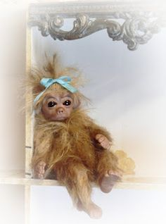 Minnow, a tiny monkey I made from polymer clay and mohair.  So happy that she found a good home!