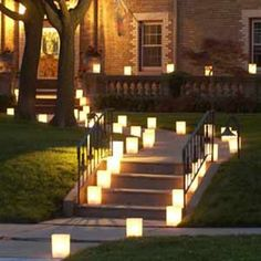 Luminaries - paperbags, sand and a votive candle. these could be really cool if we put them out lining the walkway as people leave the reception & for our exit