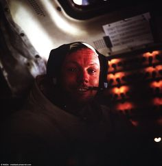 Neil Armstrong, Apollo 11 commander, is pictured inside the Lunar Module while it rested on the surface of the moon. Three years earlier he had made his first space flight as the command pilot of Gemini 8, a mission which made him  NASA's first civilian astronaut to fly in space. Armstrong, a former Air Force pilot, marked the Eagle's landing with a brisk handshake with Aldrin before preparing the vessel for a quick liftoff in the event of an emergency