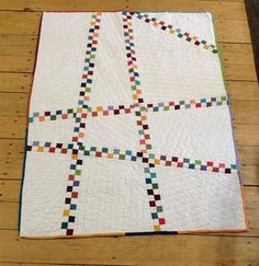 Baby quilt made with extra 4-patches
