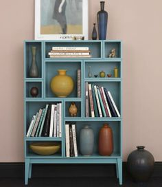I feel like I could make this...different size wooden cubbies on tob of maybe a bench/coffee table? Spray paint one color.
