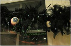 Eyeball Feather Garland (Twist two feather boas together, twist tie crafted eyeballs on to it.)