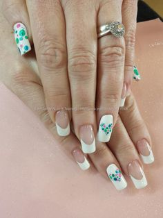 White gel polish with teal and green dots and spots