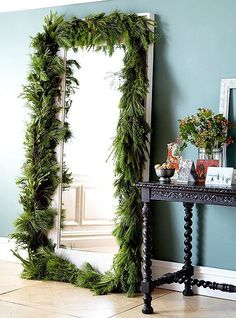 Just like a doorway, an oversize mirror is a perfect candidate for a garland border. Add a swag at the top or trim out all four sides to see your space (and yourself!) in a festive new way.