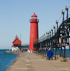 Grand Haven Lighthouse has 2 buildings, the outer, which is square/integral, was established in 1875 and the inner conical light in 1905. These lights are connected by a catwalk.