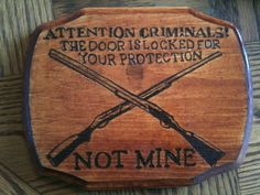 Funny wooden Pro Gun warning sign with two rifles via Etsy