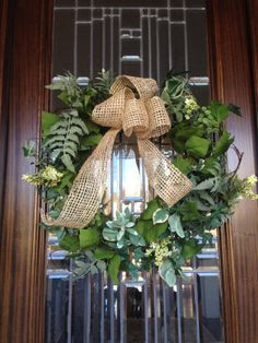 Mixed varigated foliage wreath with burlap ribbon by Wreathmarket, $85.00 beautiful wreath year round!