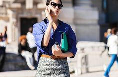 Blue button up tucked into a printed skirt