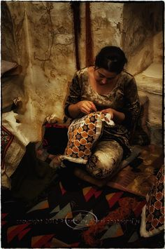 woman embroidering...rembrandt lighting