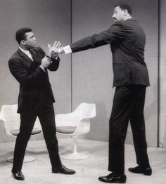 Muhammad Ali and Wilt Chamberlain prior to being interviewed by Howard Cosell about a potential novelty fight between the two, 1967, by Howard Bingham