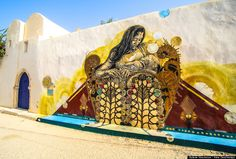 The 21 Best Acts Of Street Art In 2014 , part of a very large neigghborhood  project 'Djerbahood'