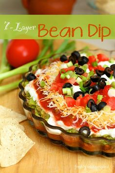 Bean Dip - Freshly Photographed <br> This Bean Dip recipe uses fresh vegetables and your favorite salsa, delivering seven layers of deliciousness on a single tortilla chip. Mexican Dip Recipes, Mexican Dips, Bean Dip Recipes, Mexican Appetizers, Appetizer Dips, Appetizer Recipes, Bhg Recipes, Party Appetizers, Mexican Style