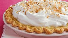 Enjoy this coconut pie topped with whipped cream- a wonderful dessert baked using Pillsbury® pie crusts.