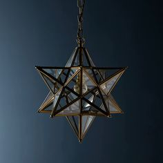 Twinkle Twinkle little...star pendant. Antique brasswork with clear glass. A very classy centrepiece.