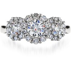 Beloved Three Stone Engagement Ring, a modern take on the classic three-stone diamond engagement ring, the cluster design of perfectly cut Hearts On Fire diamonds results in ultimate sparkle and brilliance.  Available in platinum or 18K white gold. 603-749-3129