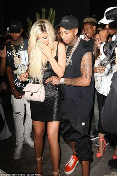Tactile: Tyga placed a loving hand around Kylie's waist as he presented her with the keys to her new ride