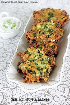 Spinach, Cheese & Potato Pancakes: Shredded potatoes, fresh baby spinach, salty bites of feta cheese, spring onion and sweet, aromatic dill help turn these tasty latkes into objects of affection. These pancakes have crispy, wispy edges and firm middles - just delicious! Makes 10-11 in about 40 mins. Serve with a dollop of Tzatziki cucumber sauce or sour cream for a tasty appetizer or anytime snack. | The Micro Gardener