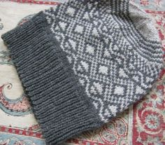 I made this hat as a birthday present for my dad as he recently moved to the mountains where he can expect buckets of snow.I used this 'Simple Hat calculator':http://www.earthguild.com/products/knitcroc/marypat/hatcalc.htmand created the fair isle motif using 200 Fair Isle Motifs by Mary Jane...