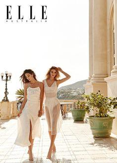 Photographed in Malibu, California, Lily Aldridge and Rosie Huntington-Whiteley pose in dreamy white dresses
