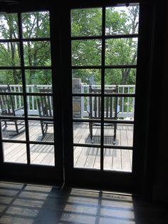The porch at Woodford Reserve, as seen through the cafe doors. #bourbon #Kentucky #Bluegrass #kentuckybourbontrail #bourbontrail #WoodfordReserve