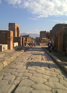 Pompeii, Italy - City preserved from volcanic eruption of ash and pumice from Mount Vesuvius year AD 79. Shows a paved street worn from passing chariots.