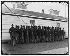 Men and noncoms of Company E, 4th U.S. Colored Infantry, at Fort Lincoln, Washington D.C. The bottom rail is on top, as these soldiers were among the 180,000 black men who served in the Union army during the war—and helped deliver ultimate victory.