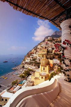 Beautiful Positano Village, Italy. Whichever hotel this balcony belongs to, I want to be sitting on it someday.