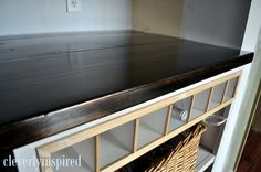 Two 2x12's + One 2x4 cut to the length of your counter + conditioner, stain and sealer = super affordable wood countertop.