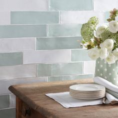 The traditional and handmade style of the Artisan White wall tile makes it a great addition to vintage style schemes throughout the home. A classic and elegant white, this versatile ceramic tile is an interesting 75mm x 300mm, and is also available in a smaller size which creates an unusual feature wall when they're used alongside one another. Available in a palette of eight other vintage style colours, try using a couple together for a unique feature. PLEASE NOTE: Samples for this tile…