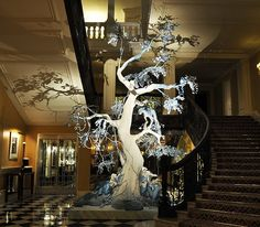 Now that's a foyer - non traditional Christmas tree designed by John Galliano
