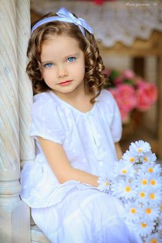 Ringlets are popular for flower girls. Good luck getting them to stay in baby-fine hair!