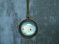 Birds blue glass pendant - Birds necklace - blue white black - romantic jewelry - glass dome pendant - Swan pendant. $18.00, via Etsy.
