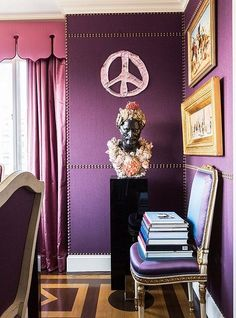 Inside the stunning home of the Ultimate A-list decorator: Alex Papachristidis. Nail-head trim imitates paneling on the dining room wall. Alex had the shell-covered bust created after an antique spotted in Paris, and the glass peace sign is by favorite artist Rob Wynne. Photo by Lesley Unruh. One Kings Lane Designer Houses.