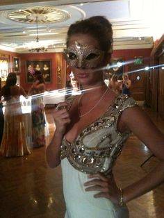 Elegant Masquerade Masks for Prom | Caggie wears a dainty silver Venetian mask with macrame lace overlay ...