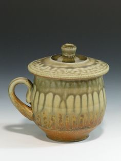 *Ceramic Lidded Mug by Jon Arsenault .