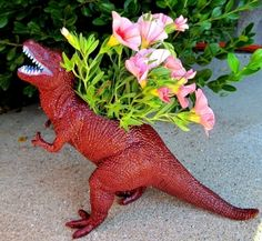 Dinosaur Planter Tutorial:  I love this! Although, I prefer the ones I saw that were hot pink (the color real dinosaurs were-- haha!) and had succulents in them (much more prehistoric looking). I'll probably add a manly little necktie to mine (or a big floppy hat, if it's a girl).