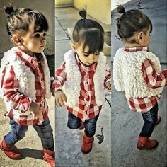 Back to school outfit faux fur vest, plaid shirt untucked, jeans and boots. Hair in topknot or to buns on sides