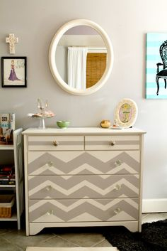 Painted dresser with chevrons and stripes. love the gray and cream colours!