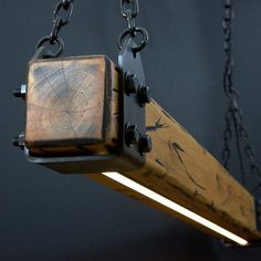 This is a reclaimed timber with an LED strip light recessed into it. It can be suspended or wall mounted with brackets. It comes with a remote and is dimmable Led Pendant Lights, Pendant Lighting, Lampe Edison, Wc Set, Cypress Wood, Linear Lighting, Rustic Lighting, Wood Chandelier, Ceiling Canopy