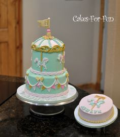 Pastel colored tiered carousel cake for baby's first birthday.  Coordinated...