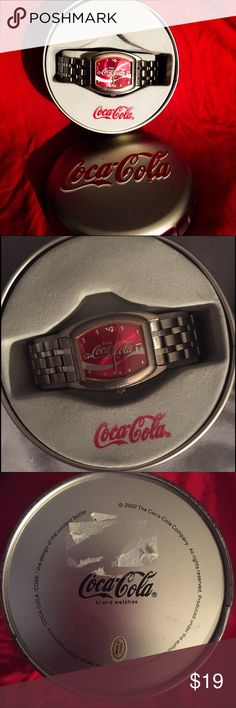 """NWT Coca Cola quartz watch collectors authentic """"Produced under the authority of the coca-cola company ... """"COCA-COLA"""", """"COKE"""" the design of the contour bottle."""" new in box collectors Coca-Cola quartz trademark watch NWT flat silver and red watch new great condition .. Comes with tin box Coca-Cola , coke  Accessories Watches"""